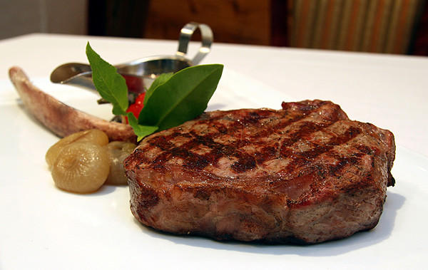 "The bone-in rib-eye steak at Vines Grille & Wine Bar off West Sand Lake Road in Orlando.<br><br><a href=""http://findlocal.orlandosentinel.com/listings/vines-grille-and-wine-bar-orlando-1"">Get venue details here</a>"