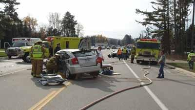 Emergency personnel tend to the scene of a three-vehicle accident Wednesday along U.S. 31 north of Petoskey.