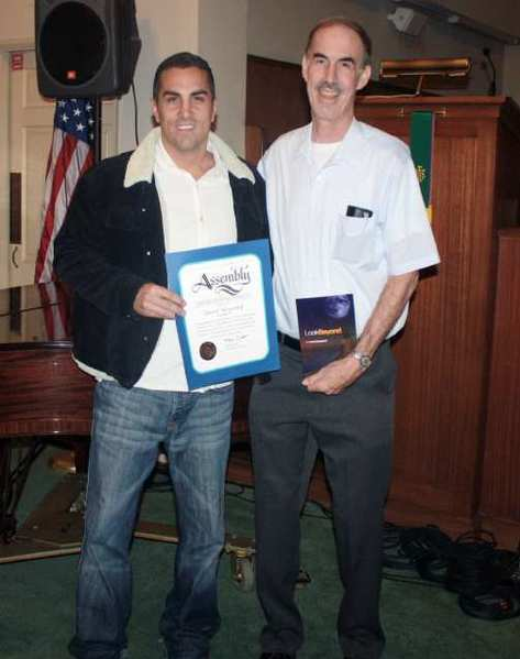 "Assemblyman Mike Gatto, left, presents a Certificate of Recognition from the California Legislature Assembly to David Meyerhof of Burbank who has published a book on poetry titled ""Look Beyond."""