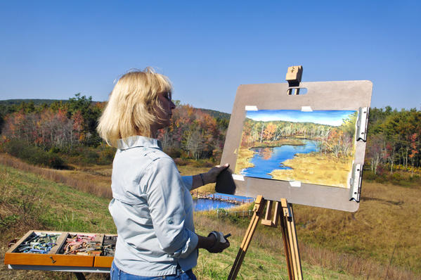 "10.04.2012 - Stafford, CT - ""The fall is so hard to recreate. Nature is a much better artist than me."""" says Stafford artist Pat Morris, stepping back to examine her pastel drawing of the view from atop the earthen dam at Ellithorpe Reservoir in Stafford. Morris, who once made her living painting pet portraits says her primary interest now is painting wild animals on feathers. She found this spot years ago on a walk while she was having her car repaired but returns seasonaly, including in winter, to illustrate the scene's beauty."