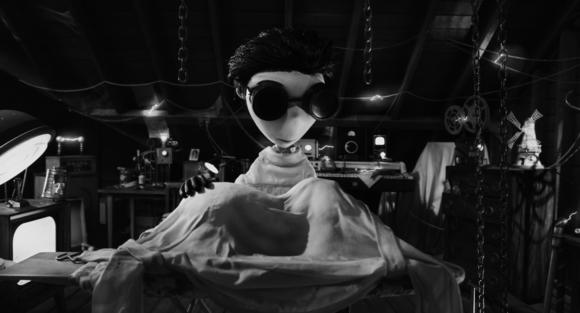"Surrounded by equipment in his attic lab, Young Victor (voiced by Charlie Tahan) attempts to bring his beloved dog Sparky back to life with lessons he learned about electricity from his science teacher Mr. Rzykruski (voiced by Martin Landau) in ""Frankenweenie."""