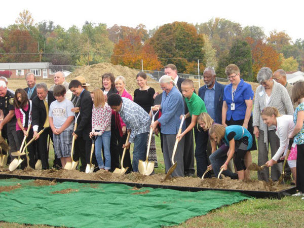 Students, school and state and local officials grabbed shovels Wednesday morning and threw a little dirt to signify the start of construction for a $13 million expansion of Harpers Ferry Middle School.