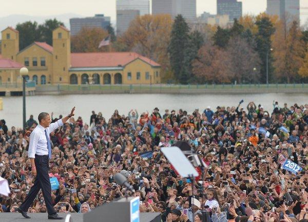 President Obama arrives on stage for a campaign event at City Park in Denver.