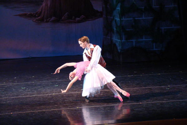 "Django Allegretti (as Darien) and Nicole Kelsch (Princess Elayna) perform a pas de deux during ""Ballet Theatre of Maryland's production of ""The Dancing Princesses."""