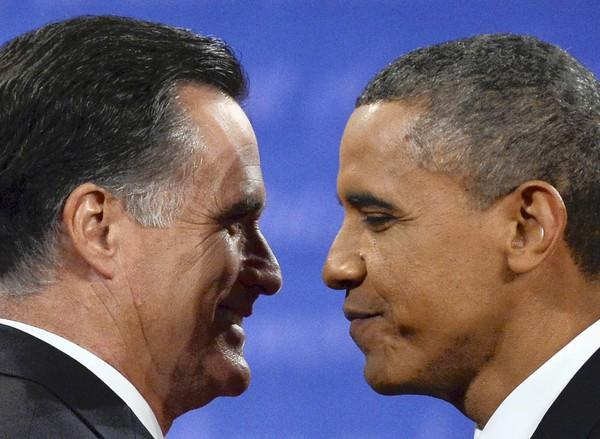 October 22, 2012. President Obama greets Republican presidential candidate Mitt Romney, left, following the third and final presidential debate at Lynn University in Boca, Raton, Fla.