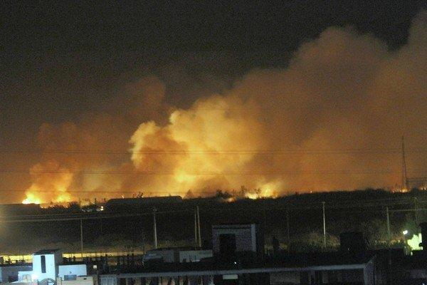 The Yarmouk arms factory in Khartoum, Sudan's capital, burns Tuesday after an airstrike. Sudan said Wednesday that Israel was behind the attack.