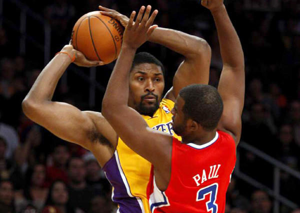 Lakers forward Metta World Peace grabs a rebound and looks to pass against Clippers point guard Chris Paul during a game last season.