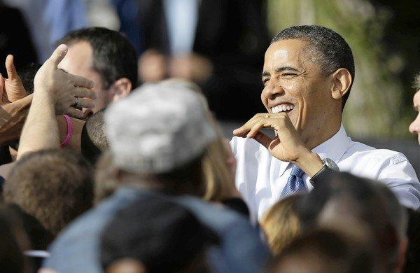 President Obama campaigns in Iowa, where voters interviewed seemed unusually upbeat. Mitt Romney was also campaigning in the crucial state, where polls show him in a dead heat with the president.
