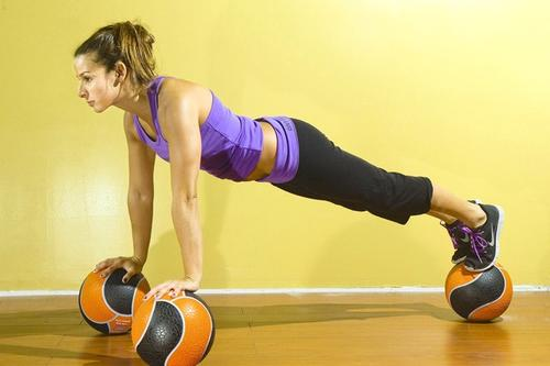 "Medicine balls, stability balls, basketballs and BOSUs can all be used to decrease stability, working more muscles. Pausing at the beginning, end or middle of a movement will make it even harder. Some research shows unstable surfaces may increase the activation of the muscles that stabilize the shoulders, but studies are inconclusive. Wobbly surfaces will, however, definitely increase trunk stabilization,"" Suprak said. And the chest can drop lower than normal if you're on three balls, so be cautious about going deeper, Olson said. ""Basically, all your muscles are doing double duty; they're moving and stabilizing you, which can easily lead to injury.""<br /><br />Calderon, the pushup champ, sets up for medicine ball pushups by putting each hand on a ball. ""Then it's one foot at a time until I'm stable,"" said Calderon, who is shooting for a new record: pushups using just two medicine balls."
