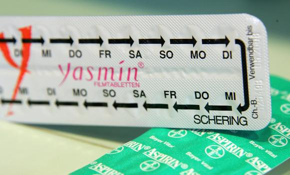 Packages of Yasmin contraceptive pills lie on a table at a pharmacy