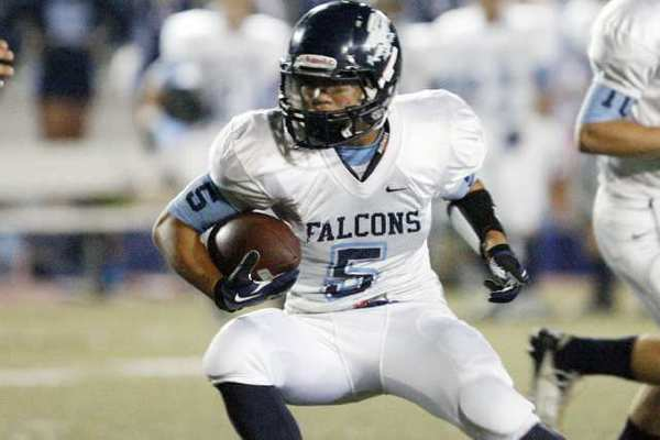 ARCHIVE PHOTO: Crescenta Valley's running back William Wang cuts back a run against Glendale.