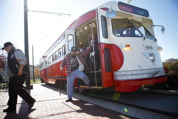 Passengers exit one of Kenosha's five operational streetcars that travel a two-mile route through downtown and to the lakefront. Kenosha installed a vintage streetcar line along its redeveloped lakefront in 2000