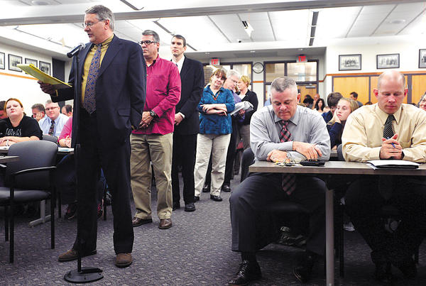 Speakers line up Wednesday night to address the Chambersburg (Pa.) Area School Board about the proposed districtwide student dress code. The meeting room at the district administration building was packed.