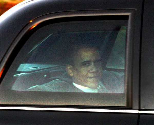 "President Barack Obama looks out the window of the limousine in a motorcade leaving the Bob Hope Airport in Burbank on Wednesday. President Obama was heading to NBC studios for ""The Tonight Show with Jay Leno."""