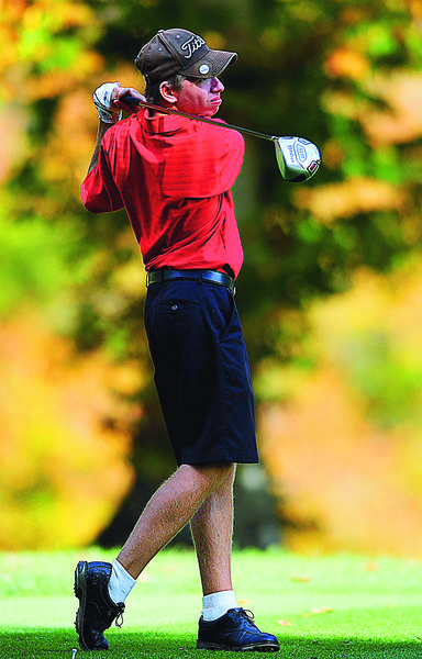 North Hagerstown's Drew Miguel follows the ball after striking his tee shot on No. 8 of the University of Maryland Course on Wednesday during the final round of the Maryland State Golf Tournament.