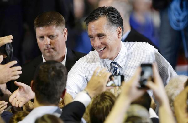 Mitt Romney greets supporters at the Eastern Iowa Airport in Cedar Rapids. President Obama also campaigned in Iowa, about 80 miles away.