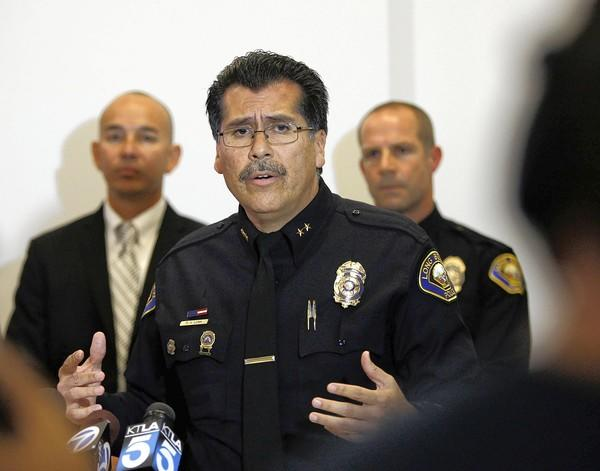 Deputy Chief Robert Luna of the Long Beach police speaks during a news conference announcing an arrest in the investigation of an attack with a fire bomb.