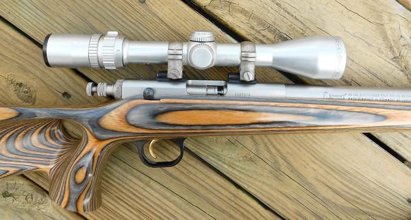Knight Master Hunter Extreme .50 Cal. In-line Wood laminate thumbhole stock, Stainless steel barrel w/Bausch&Lomb 3x9 Scope (silver) #S107070. The gun was presented by Tony Knight, founder of Knight Rifles, to Tom in 1999 for outstanding communication and writing about muzzleloading. The stainless steel barrel is engraved to Tom Fegely 1999 Master Hunter.