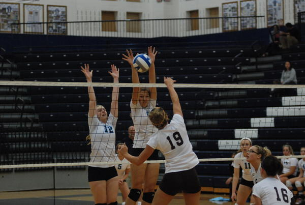 Petoskey senior setter Shannon Cosens (left) had 35 assists and four kills while Megan Tompkins (middle) added 17 kills, 18 digs, two aces and a block as the Northmen defeated Alpena, 25-12, 25-19, 25-17, Wednesday in a Big North Conference match.