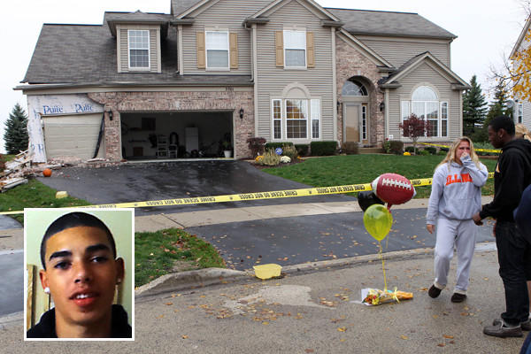 Teens stand at the scene of a fatal crash in Aurora where a Devin Meadows, 15, (inset) was killed when he was thrown from a car that crashed into the house.