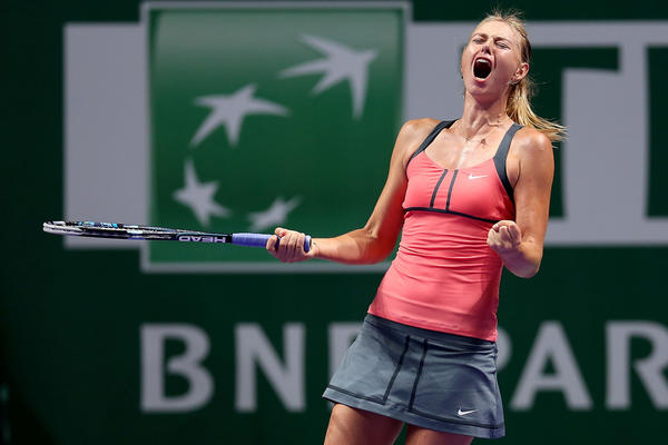 Maria Sharapova of Russia celebrates breaking Agnieszka Radwanska of Poland late in the third set in round robin play during the TEB BNP Paribas WTA Championships at the Sinan Erdem Dome October 24, 2012 in Istanbul, Turkey.