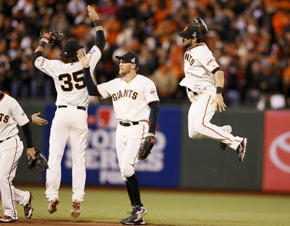 San Francisco Giants center fielder Angel Pagan (R) celebrates with teammates Brandon Crawford (L) and Hunter Pence after the Giants defeated the Detroit Tigers in Game 1 of the MLB World Series baseball championship in San Francisco, October 24, 2012.