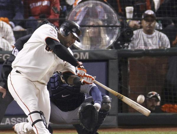 San Francisco Giants' Pablo Sandoval hits his third home run of the game against the Detroit Tigers in the fifth inning of Game 1 of the MLB World Series baseball championship in San Francisco, October 24, 2012.