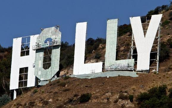 Painters work Wednesday on the Hollywood sign makeover. Credit: Mel Melcon / Los Angeles Times