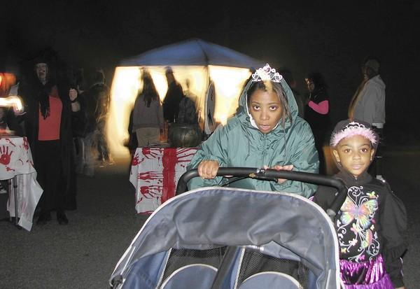 Photos by Marcie Renner Trick-or-treaters make their way along Ketch Court in York County's Creekside Landing last year on Halloween.