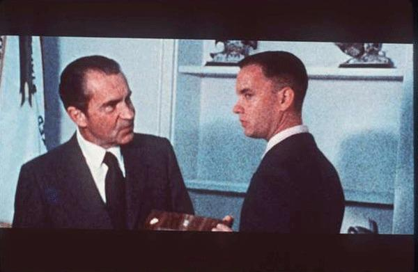 In scene from the movie, Richard Nixon greets Forrest Gump.