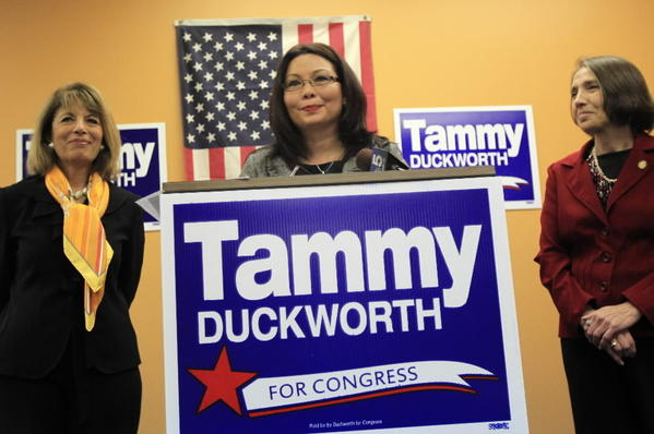 Democrat Tammy Duckworth speaks during a news conference while U.S. Congresswoman Jackie Speier, left, and Bonnie Grabenhoer (cq), right, Executive Vice President of National Organization of Women, look on Thursday.