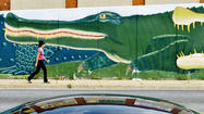 """You know when you see John Ellsberry's painted alligator at the end of the 28th Street Bridge that you're in Remington,"" said Kathleen C. Ambrose, who is researching and writing a history of the more than 200-year-old Baltimore neighborhood that she hopes to have published next year."