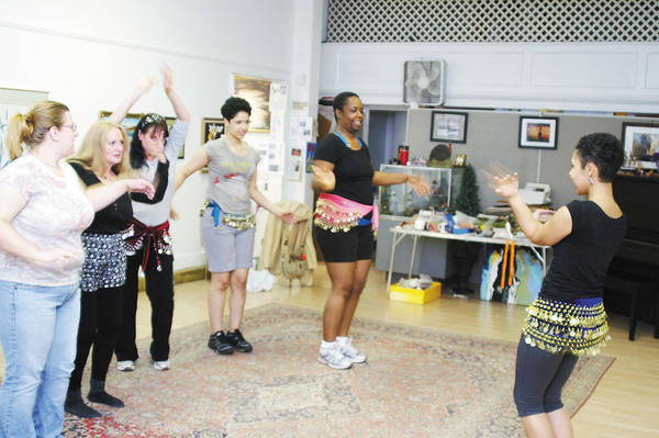 Instructor Camile Frayser, right, leads a belly dancing class Oct. 12 at Contemporary School of the Arts and Gallery Inc. Those in the class, from left, are Kathy Waldron, Earlene Sorrells, Natalie Barthlaw, Chrishanna Frayser and Andrea Frayser.