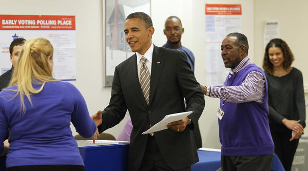 President Barack Obama arrives at a polling place in the Bronzeville neighborhood of Chicago to cast his vote early for the upcoming election.