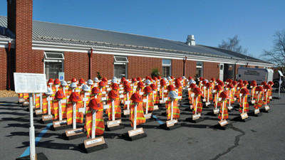 The state Department of Transportation Traveling Worker Memorial was displayed in Berlin as part of Somerset County safety day. The memorial includes 84 crosses representing employees who have died on the job since 1970.