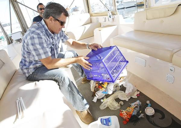 Billy Dutton dumps an example of the harmful plastics they found while on a coastal trip from Santa Barbara to the Mexican border.