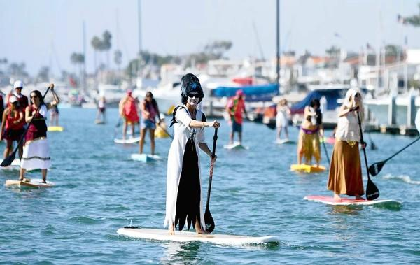 A large group of paddlers head through Newport Harbor in a previous Paddle for Privates event.