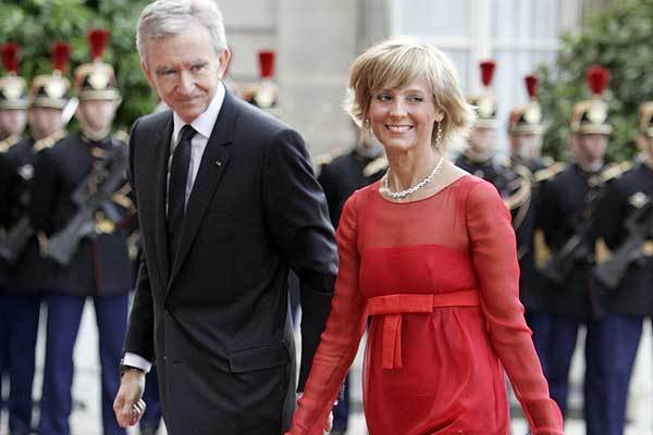 France's richest man, Bernard Arnault, and his wife, Helene. Arnault said his move to Belgium is not a ploy to avoid France's high tax rates.
