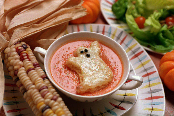 Serve the kids this creamy tomato soup with cheesy ghost-shaped toasts before they go out into the night.