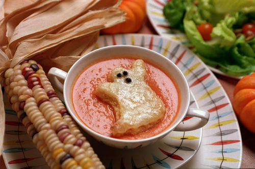 "Serve the kids this creamy tomato soup with cheesy ghost-shaped toasts before they go out into the night. <a href=""http://articles.latimes.com/2001/oct/31/food/la-fo-halloweenrec1a-2009aug27"">Click here for the recipe.</a>"