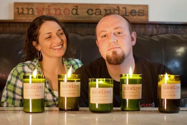 "Anna and Dave Neith, owners of Unwined Candles, a Sykesville home-based business that makes all natural soy-wax candles using recycled wine bottles as containers. The company has been chosen to give out the candles as ""gifts"" to celebrity musicians at the 2012 CMA awards in Nashville on Nov. 1."