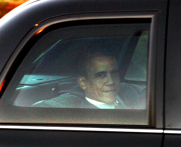 President Barack Obama looks out the window of the limosine in a motorcade leaving the Bob Hope Airport in Burbank on Wednesday, October 24, 2012. President Obama was heading to NBC studios for the Tonight Show with Jay Leno.