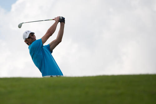 lympic gold medallist swimmer Michael Phelps of the US tees off on the final day of the World Celebrity Pro-Am golf tournament at the Mission Hills golf resort in Haikou on the southern Chinese island of Hainan on October 21, 2012.