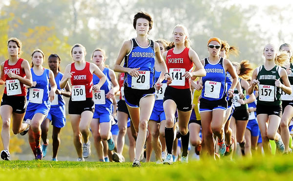 Boonsboros Sarah Zielinski (20) leads North Hagerstowns Emily Ward (141) and the rest of the pack at the start of the girls race Thursday at the Washington County championships.
