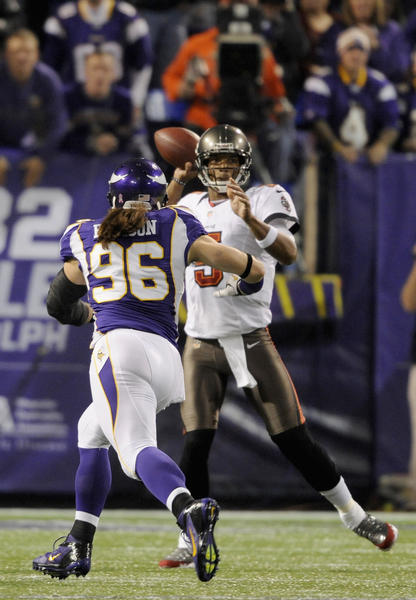 Josh Freeman #5 of the Tampa Bay Buccaneers looks to pass while under pressure from Brian Robison #96 of the Minnesota Vikings during the first quarter of the game on October 25, 2012 at Mall of America Field at the Hubert H. Humphrey Metrodome in Minneapolis, Minnesota. Tampa Bay won 36–17.