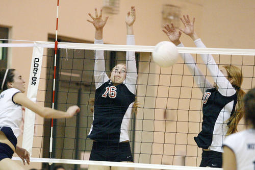 FSHA's Sophia Coffey, center, and Allison Clapp block a spike during a game against Notre Dame at Flintridge Sacred Heart Academy in La Canada on Thursday, October 25, 2012.