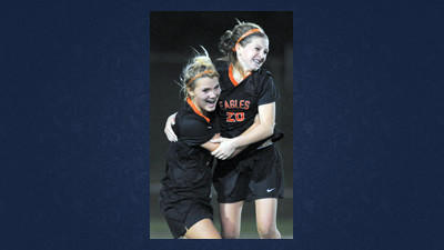 "Somerset's Lexi Pucci congratulates teammate Maddie ""Mad Dog"" McKinley (20) after she scored the winning goal with less than two minutes to play. The Lady Eagles defeated Ligonier Valley in a first-round playoff game in Sidman."