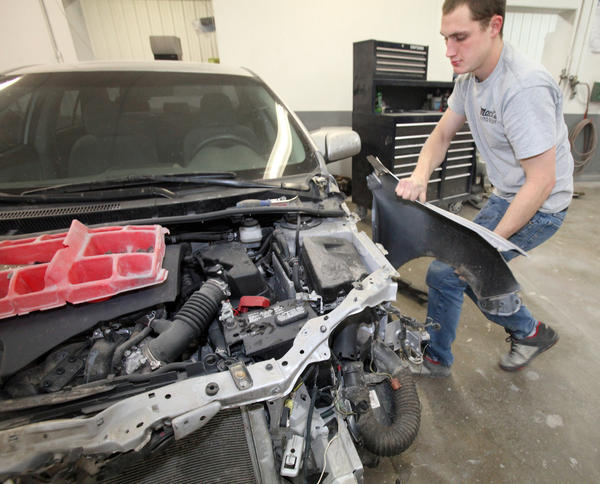 Kenneth Robinson, a technician with Mack's Auto Body, removes the driver's side front fender as he takes apart a car that struck a deer. According to accident records from State Farm Insurance, South Dakota has the second-highest rate of vehicle vs. deer accidents in the nation.