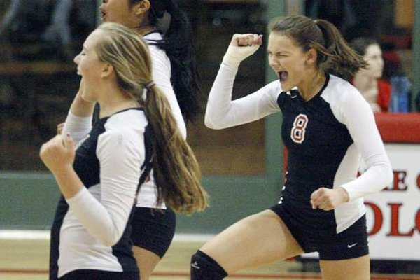 FSHA's Meghan Lacey, right, rejoices with her team after a kill. She had 14 kills on the night.