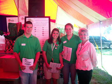 The 4-H Benefit Auction took place Sept. 2 in Huron during the South Dakota State Fair. Taking part in the event was, from left: Garrett Stafford of Ipswich, Katie Martinez of Rapid City and Emily Ketteler of Fort Pierre, all South Dakota Youth Council members; and Nancy Swanson of Brookings, 4-H Foundation executive director.